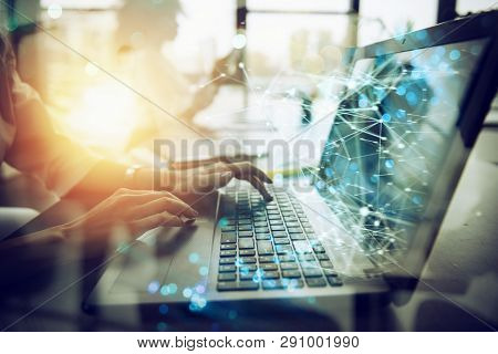 Businesswoman Works In Office With A Laptop With Internet Effects. Concept Of Internet Sharing And C