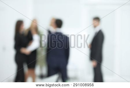 Blurred Image Of Business Team On Office Background.business Background