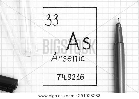 The Periodic table of elements. Handwriting chemical element Arsenic As with black pen, test tube and pipette. Close-up. poster