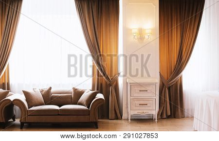 Photo Of Hotel Room Or Restaurant With Elegant Curtains, And Sofas, Big Windows, With Vintage Lamp O