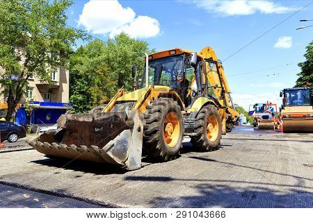 Heavy Construction Bulldozer And Vibratory Rollers During Asphalt Road Repair On A City Street At No