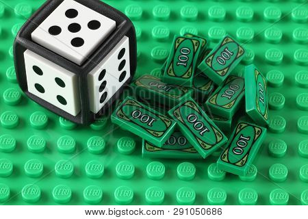 Tambov, Russian Federation - May 08, 2013  Lego Money Blocks  And Lego Cube On A Green Baseplate. St
