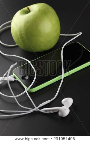 Tambov, Russian Federation - October 16, 2013 Apple Iphone 5c Green Color, Apple Earpods And Green A