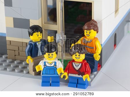 Tambov, Russian Federation - January 12, 2014 Happy Lego Family Standing Near His Home. There Are Mi