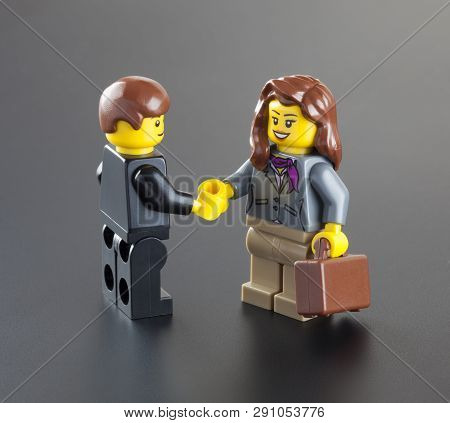 Tambov, Russian Federation - October 04, 2013 Lego Minifigures Businessman And Businesswoman With Su