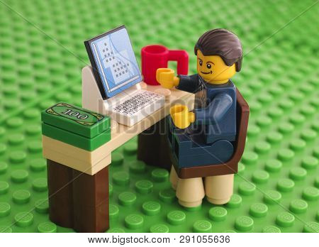 Tambov, Russian Federation - March 24, 2015 Lego Businessman Sits At His Working Table With Computer
