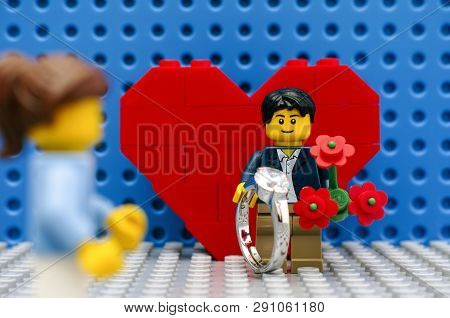 Tambov, Russian Federation - September 03, 2015 Lego Man Minifigure With Ring And Red Flowers Meetin