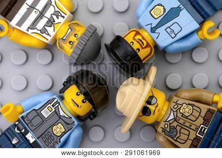Tambov, Russian Federation - May 12, 2016 Three Lego Policemen And One Criminal Minifigures On Lego