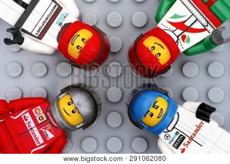 Tambov, Russian Federation - July 06, 2016 Four Lego Driver Minifigures On Lego Gray Baseplate Backg