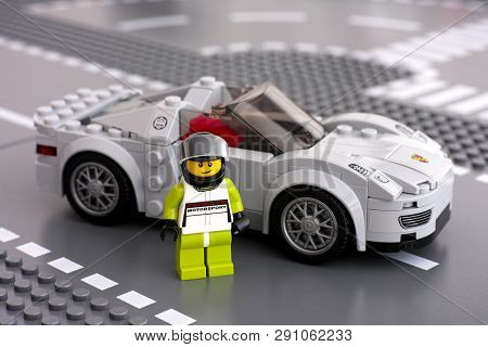 Tambov, Russian Federation - March 14, 2015 Lego Porsche Motorsport Driver Minifigure And His Car By