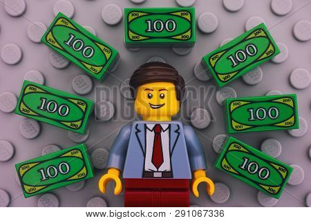 Tambov, Russian Federation - June 22, 2017 Lego Businessman And Lego Money On Gray Baseplate Backgro