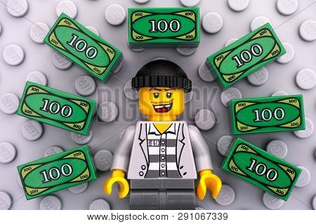 Tambov, Russian Federation - June 22, 2017 Lego Criminal And Lego Money On Gray Baseplate Background
