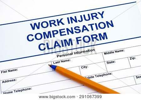 Work Injury Compensation Claim Form With Ballpoint Pen