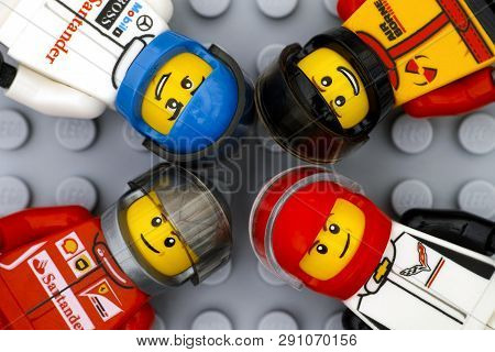 Tambov, Russian Federation - June 15, 2017 Four Lego Sports Car Driver Minifigures On Gray Baseplate