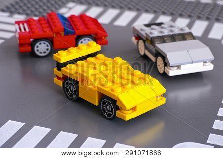 Tambov, Russian Federation - March 15, 2015 Three Lego Custom Made Cars On Lego Road Baseplate. Stud