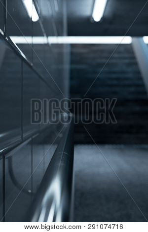 3d rendering of metal handrail in a subway underpass with staircase at the end with grains effect poster
