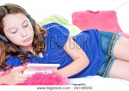 Girl playing handheld video game