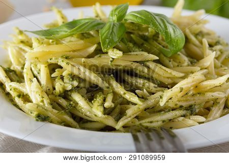 Traditional Trofie Pasta With Pesto Sauce On White Plate
