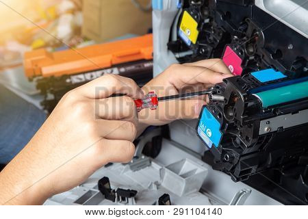 Business Man Or Technician Is Checking And Changing The Printer Equipment Cartridges Tone Of Laser J