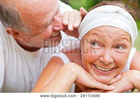 loving senior couple telling secret