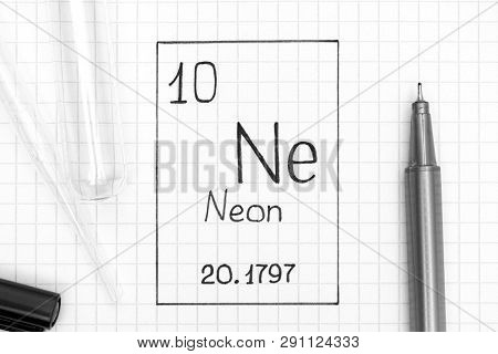The Periodic table of elements. Handwriting chemical element Neon Ne with black pen, test tube and pipette. Close-up. poster