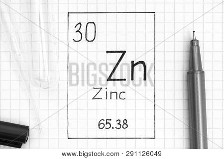 The Periodic Table Of Elements. Handwriting Chemical Element Zinc Zn With Black Pen, Test Tube And P