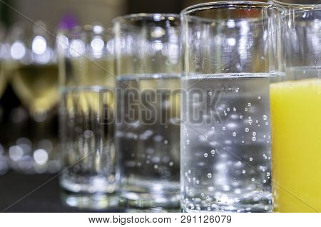 Refreshingly Cold Soft Drinks In Tumbler Drinking Glasses On A Bar Table As A Catering Concept. Focu