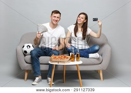 Smiling Couple Woman Man Football Fans Support Favorite Team Holding Credit Bank Card, Fan Of Money