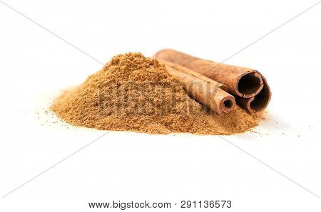 Ceylon cinnamon sticks and ground cinnamon on a white background