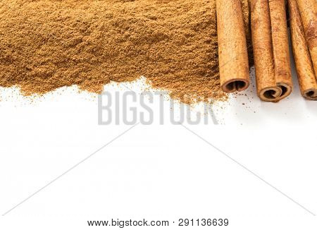 Ceylon cinnamon sticks and ground cinnamon on a white background