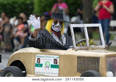 Louisville, Kentucky, Usa - May 03, 2018: The Pegasus Parade, A Clown Car, With A Clown As Driver, G