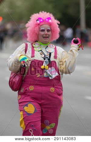Louisville, Kentucky, Usa - May 03, 2018: The Pegasus Parade, Woman Clown Witha Pink Wig, And A Horn