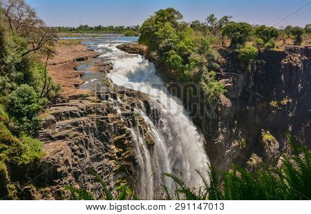 Victoria Falls Is A Waterfall Near The Cities Of Victoria Falls In Zimbabwe And Livingstone In Zambi