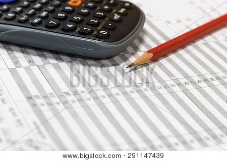 Red Pencil And Calculator On Paper Of Final Grade For Each Course At The End Of Semester. The Number