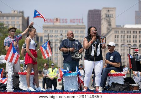 Chicago, Illinois, Usa - June 16, 2018: The Puerto Rican Day Parade, Woman Sings The Puerto Rican Na