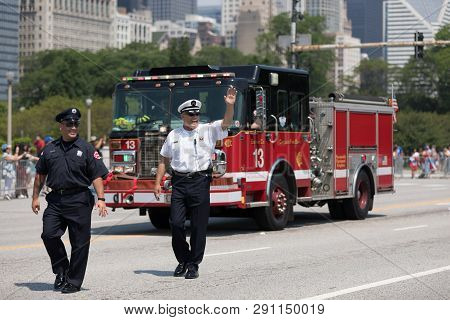 Chicago, Illinois, Usa - June 16, 2018: The Puerto Rican Day Parade, Firefighters Waving At Spectato