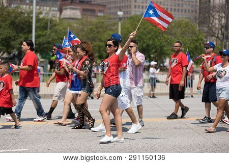 Chicago, Illinois, Usa - June 16, 2018: The Puerto Rican Day Parade, Puerto Rican People Carrying Pu