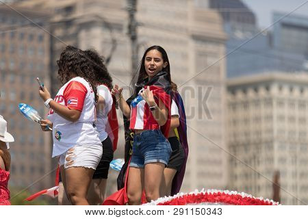 Chicago, Illinois, Usa - June 16, 2018: The Puerto Rican Day Parade, Puerto Rican Woman Wearing A Sh