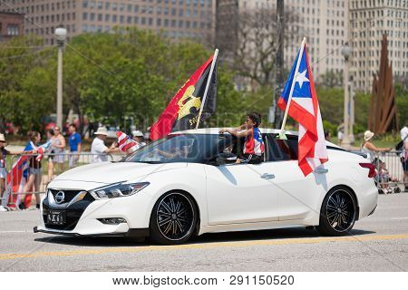 Chicago, Illinois, Usa - June 16, 2018: The Puerto Rican Day Parade, Puerto Ricans Driving A Nissan