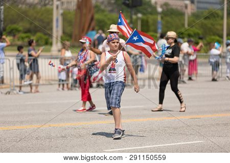 Chicago, Illinois, Usa - June 16, 2018: The Puerto Rican Day Parade, Puerto Rican Boy Waving The Pue