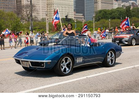 Chicago, Illinois, Usa - June 16, 2018: The Puerto Rican Day Parade, Puerto Rican Driving A  Corvett