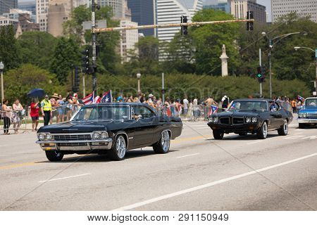 Chicago, Illinois, Usa - June 16, 2018: The Puerto Rican Day Parade, Puerto Rican Driving A Chevrole