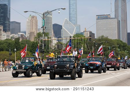 Chicago, Illinois, Usa - June 16, 2018: The Puerto Rican Day Parade, Puerto Ricans Driving Jeeps Wit