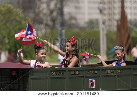 Chicago, Illinois, Usa - June 16, 2018: The Puerto Rican Day Parade, Puerto Rican Children Riding A