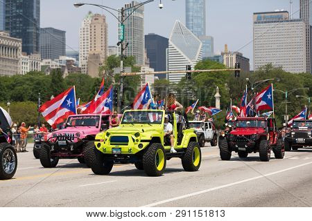Chicago, Illinois, Usa - June 16, 2018: The Puerto Rican Day Parade, Puerto Rican Driving Jeeps Carr