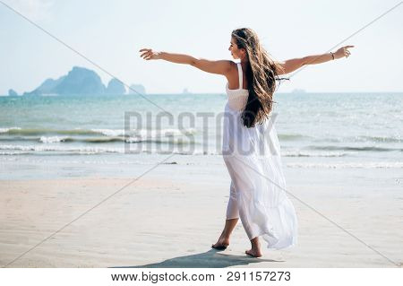 Carefree Young Woman Enjoying The Summer Beach, Full-length Shot., Carefree Young Woman Enjoying The