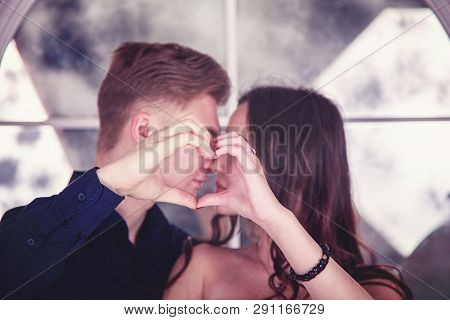 Love Story. Young Couple In Love With Hands Making Heart, Valentine Couple. Portrait Of Smiling Beau