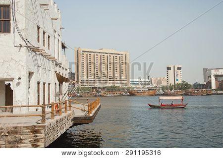 Uae, Dubai - January, 2019: Traditional Arab Abra Boat Sailing Through Dubai Creek