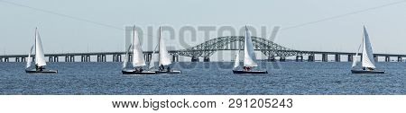 Two Person Sailboats Racing During A Winter Regatta On The Great South Bay, With The Robert Mosses B