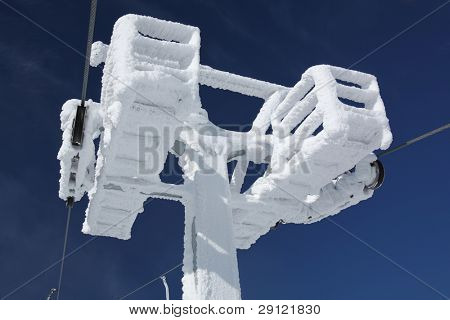Construction of the ski lift covered with ice